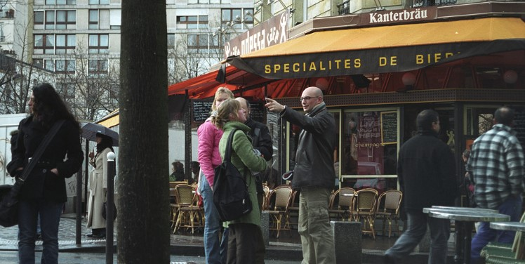 speaking with passer by while abroad