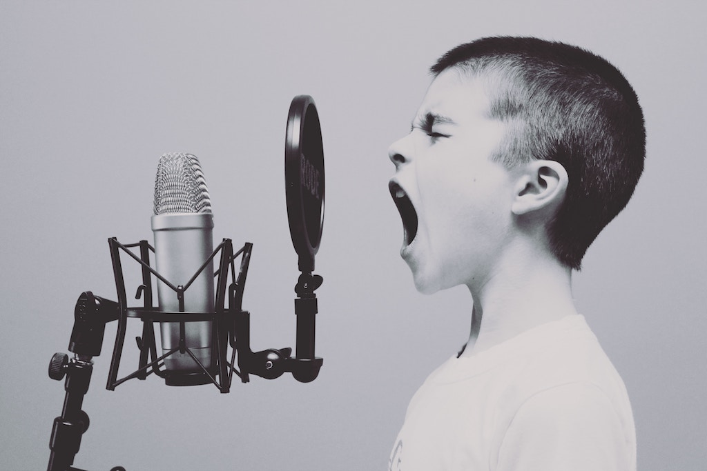 Child speaking into microphone