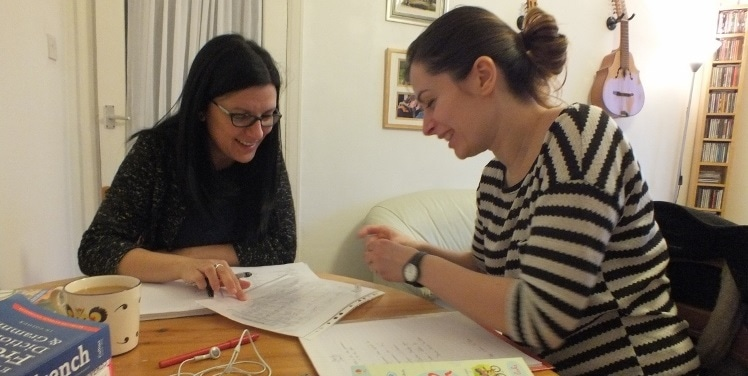 student and tutor learning french at home