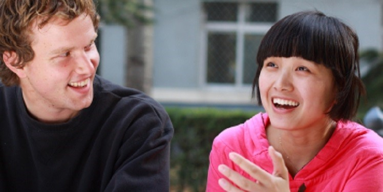 student laughing with tutor